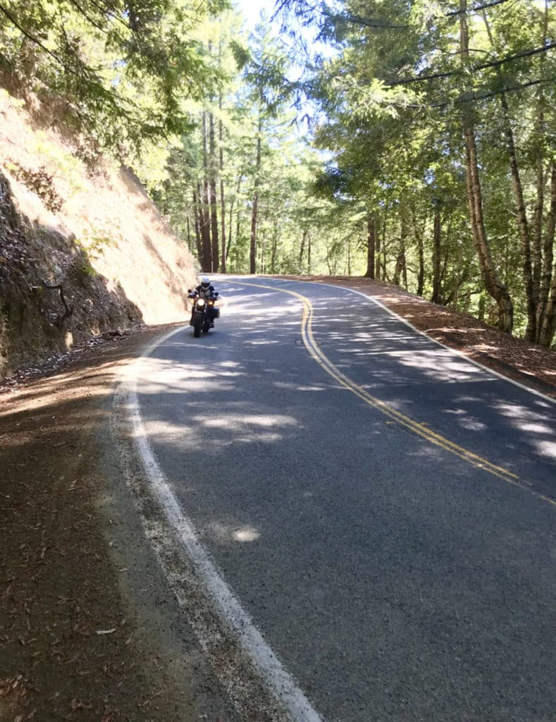 riding a motorcycle adventure over a twisty mountain pass on the west coast