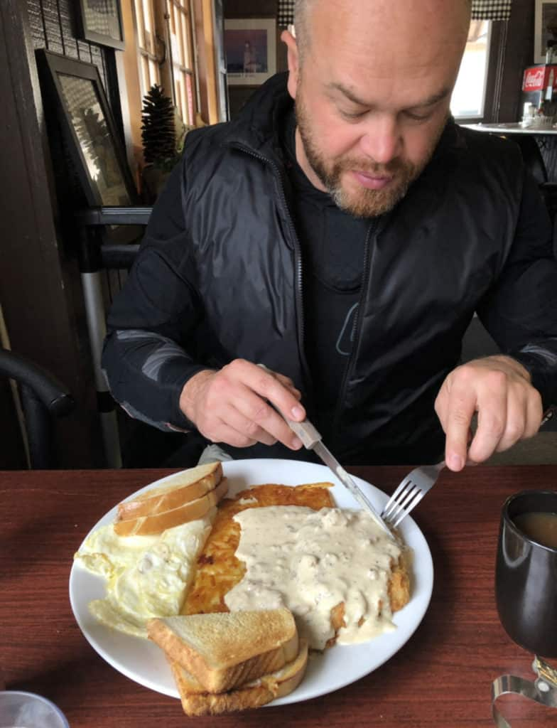 Adventure motorcyclist trying chicken fried steak for the first time