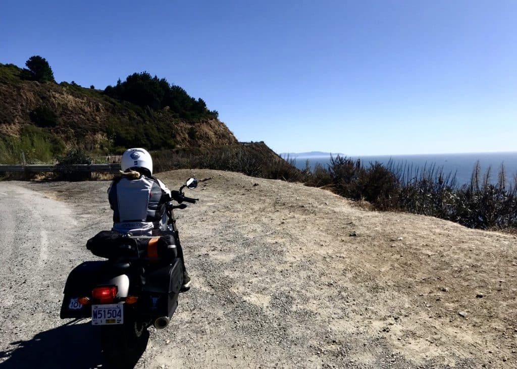 Pulling over the motorcycle to take a break with a view of the Pacific ocean